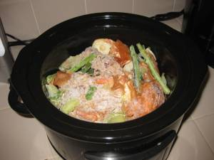 Vegetable Scraps and Bones Ready to Cook into Chicken Broth in Slow Cooker/Crockpot