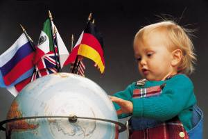 Child with globe and flags
