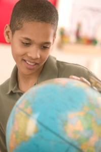 Student Looking at Globe