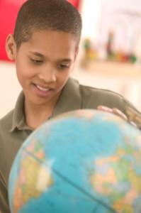 Student Looking at Globe