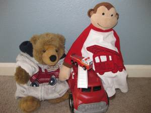 Our collection of firetruck toys and clothes