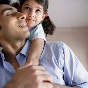 Girl Getting Piggyback Ride from Father