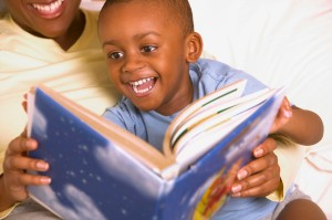 Boy Reading with Mother - How to Find Books in Spanish for Your Toddler - Alldonemonkey.com