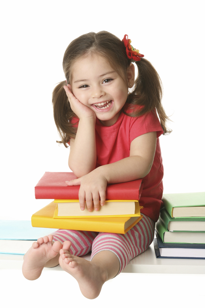 Cute little girl with book Free Photo