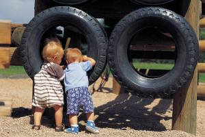 Toddlers Playing in Large Tires - Playdate Blog Hop - Alldonemonkey.com